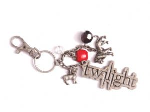 Twilight Lion and Lamb Key ring  Made of sturdy metal measuring 4 and includes charms of the lion the lamb apples faceted beads and the Twilight